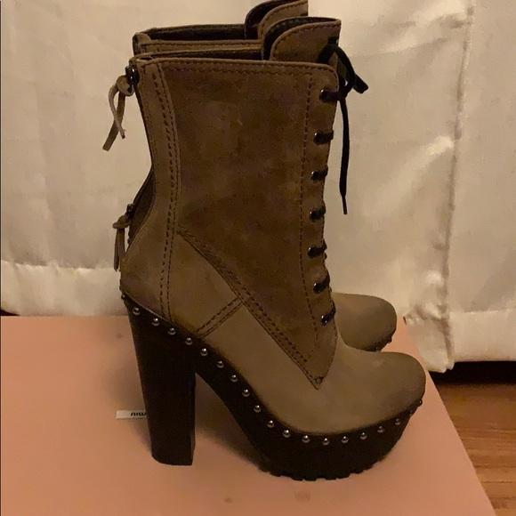 cca1634b7da9 Miu miu platform boots